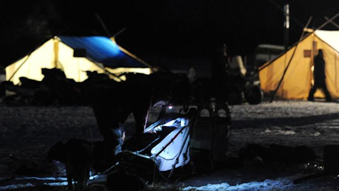 Allen Moore puts bootIes on his dog team before leaving the village of Nikolai, Alaska during the Iditarod Trail Sled Dog Race, Tuesday, March 5, 2013. (AP Photo/Anchorage Daily News, Bill Roth)