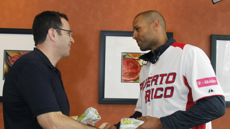 IMAGE DISTRIBUTED FOR SUBWAY -Puerto Rico and Chicago White Sox outfielder Alex Rios shakes hands with with Jared the SUBWAY Guy after surprising customers with free SUBWAY sandwiches prior to the World Baseball Classic final,  on Tuesday, March 19, 2013 in San Francisco. (Photo by George Nikitin/Invision for Subway/AP Images)