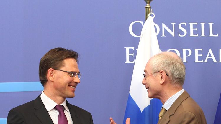 European Council President Herman Van Rompuy, right, welcomes Finland's Prime Minister Jyrki Katainen, at the European Council building in Brussels, Wednesday, Jan. 16, 2013. (AP Photo/Yves Logghe)