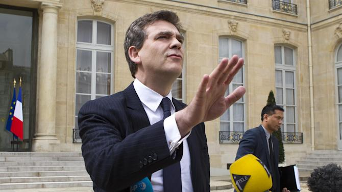 French Minister for Industrial Renewal, Arnaud Montebourg gestures with the media as he leaves after the weekly cabinet meeting in Elysee Palace in Paris, Thursday May 2, 2013. (AP Photo/Jacques Brinon)