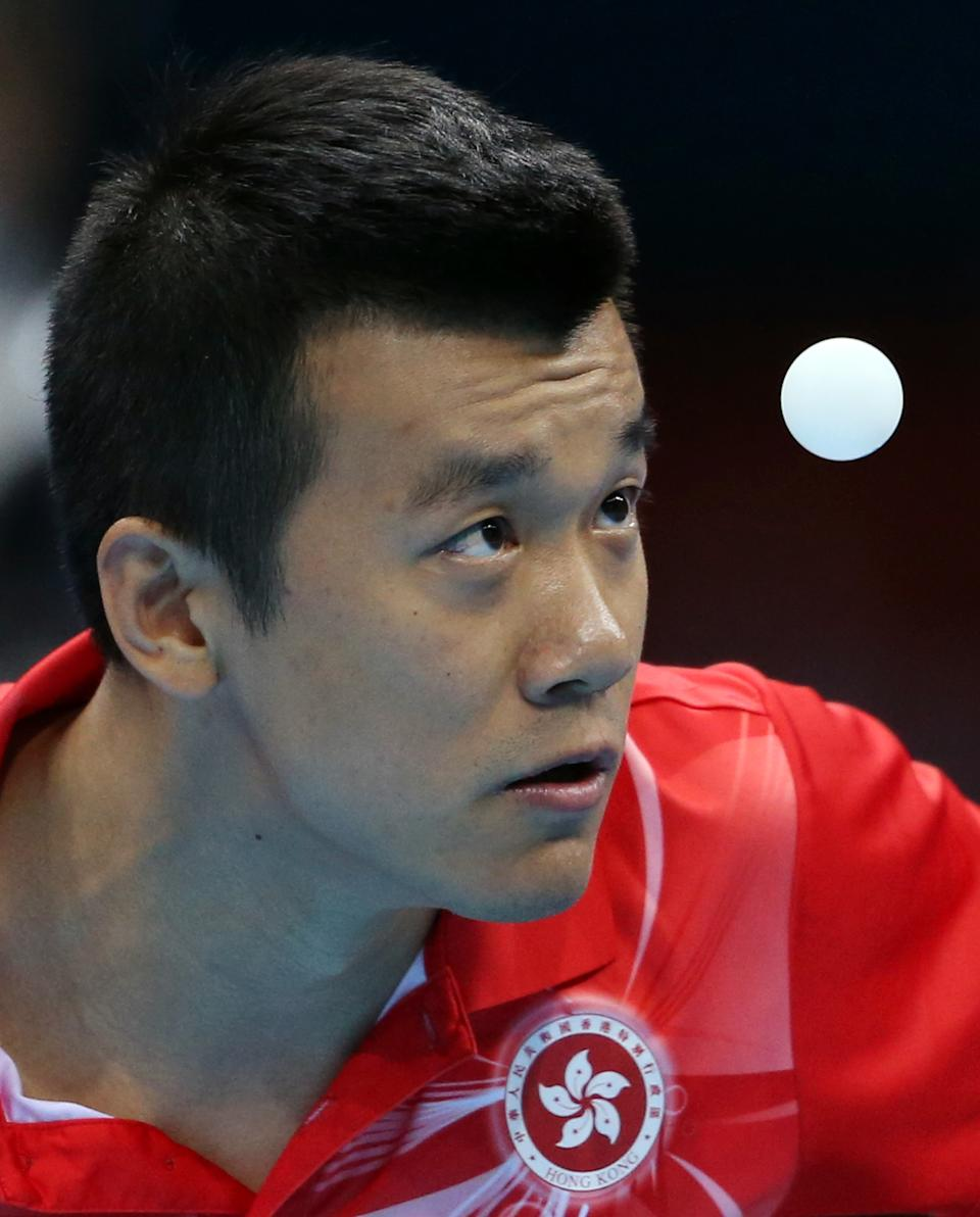 Tang Peng of Hong Kong competes against Dimitrij Ovtcharov of Germany in the men's team table tennis bronze medal match at the 2012 Summer Olympics, Wednesday, Aug. 8, 2012, in London. (AP Photo/Sergei Grits)