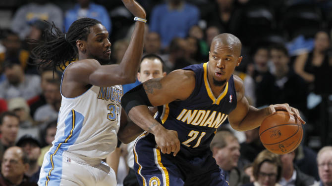 Indiana Pacers forward David West, right, works the ball inside for a shot as Denver Nuggets forward Kenneth Faried defends in the first quarter of an NBA basketball game in Denver on Monday, Jan. 28, 2013. (AP Photo/David Zalubowski)