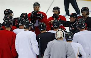 Canada's men's ice hockey team head coach Mike Babcock speaks to his team during a practice at the 2014 Sochi Winter Olympics