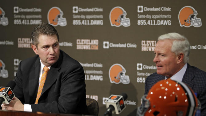 New Cleveland Browns head coach Rob Chudzinski, left, listens to owner Jimmy Haslam during an news conference at the NFL football team's practice facility in Berea, Ohio Friday, Jan. 11, 2013. Chudzinski, the Carolina Panthers offensive coordinator since 2011, becomes the 14th full-time head coach in franchise history. (AP Photo/Mark Duncan)