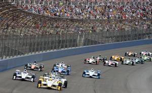 Simon Pagenaud (22), from France, leads the field toward…