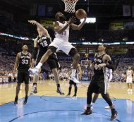 Oklahoma City Thunder guard James Harden (13) shoots as San Antonio Spurs&#39; Tiago Splitter (22), of Brazil, and Danny Green (4) defend during the first half of Game 4 in the NBA basketball playoffs Western Conference finals, Saturday, June 2, 2012, in Oklahoma City. (AP Photo/Eric Gay)