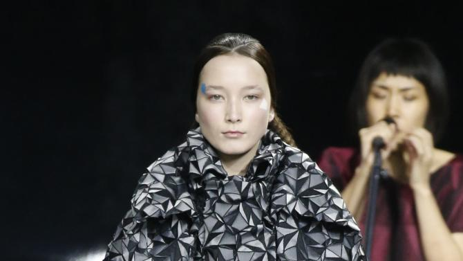 A model presents a creation by Japanese designer Yoshiyuki Miyamae as part of his Autumn/Winter 2015/2016 women's ready-to-wear collection fashion house Issey Miyake during Paris Fashion Week