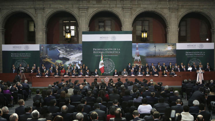 Mexico's President Pena Nieto gives a speech after signing into law a radical reform of the country's energy, at the National Palace in Mexico City