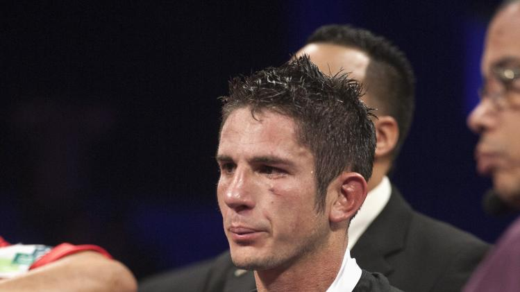 Herrera of the U.S. reacts after listening that his championship fight with WBC unified super lightweight champion Garcia of the U.S. was called a tie by majority decision, at the Ruben Rodriguez Coliseum in Bayamon