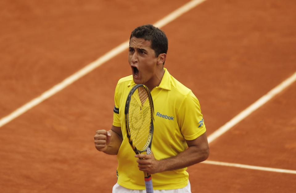 Spain's Nicolas Almagro reacts as he defeats Serbia's Janko Tipsarevic during their fourth round match in the French Open tennis tournament at the Roland Garros stadium in Paris, Monday, June 4, 2012. Almagro won 6-4, 6-4, 6-4. (AP Photo/Michel Spingler)