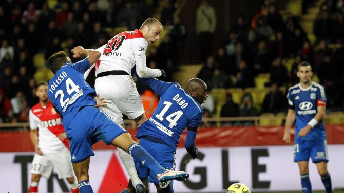 Monaco's Berbatov challenges Lyon's Dabo and Tolisso during their Ligue1 soccer match at Louis II stadium in Monaco