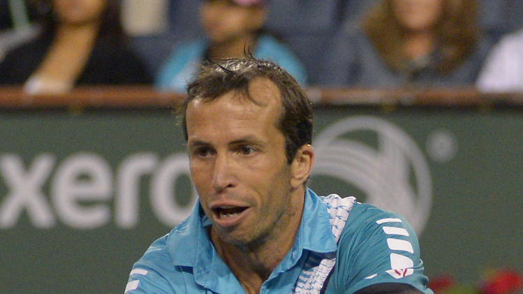 Radek Stepanek, of the Czech Republic, returns a shot to Rafael Nadal, of Spain, during their match at the BNP Paribas Open tennis tournament, Saturday, March 8, 2014, in Indian Wells, Calif