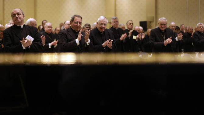 Members of the United States Conference of Catholic Bishops are seen above a piano as they applaud after Cardinal Timothy Dolan, of New York, president of the conference, spoke at the group's annual fall meeting in Baltimore, Monday, Nov. 12, 2012. (AP Photo/Patrick Semansky)