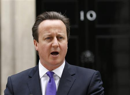Britain's Prime Minister David Cameron speaks in front of 10 Downing Street ,about the killing of a British soldier, in London