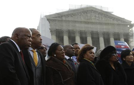 U.S. Rep. John Lewis (D-GA) (L) and Rev. Al Sharpton (2nd L) attend a voter's rights rally in front of the U.S. Supreme Court in Washington February 27, 2013. The U.S. Supreme Court on Wednesday will consider whether to strike down a key provision of a federal law designed to protect minority voters. During the one-hour oral argument, the nine justices will hear the claim made by officials from Shelby County, Alabama, that Section 5 of the Voting Rights Act is no longer needed. REUTERS/Gary Cameron