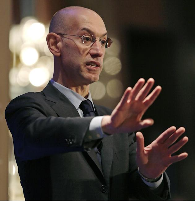 "NBA commissioner Adam Silver gestures during an address, Wednesday, March 12, 2014, in Boston. Silver commented on some teams with losing records ""tanking"" towards the end of a season as an"
