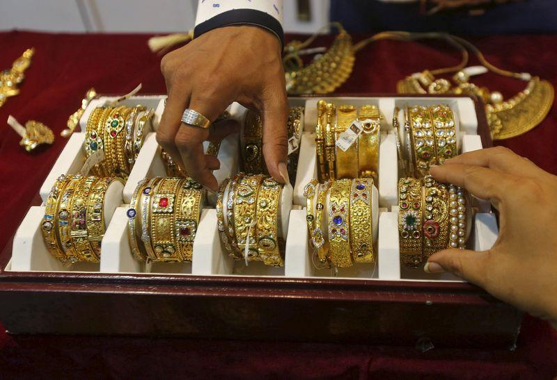 Gold holds near two-week low as U.S. rate hike looms