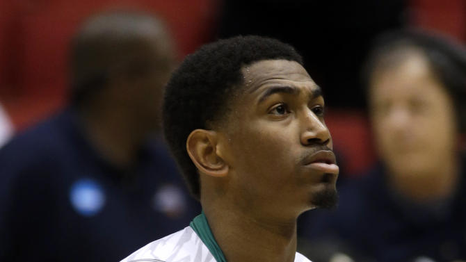 Notre Dame guard Eric Atkins walks off court after losing to Iowa State 76-58 in a second-round game at the NCAA college basketball tournament, Friday, March 22, 2013, in Dayton, Ohio. (AP Photo/Al Behrman)