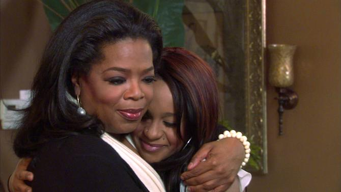 "In this undated image from video released by Harpo, Inc., host Oprah Winfrey, left, embraces Bobbi Kristina, daughter of the late singer Whitney Houston during an interview in Atlanta, Ga. The exclusive interview will be shown on ""Oprah's Next Chapter,"" on the OWN network, Sunday, March 11, 2012 at 9:00 p.m. EST. (AP Photo/Harpo, Inc.)"