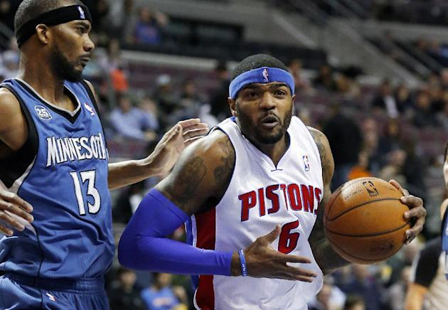 Detroit Pistons small forward Josh Smith (6) drives on Minnesota Timberwolves small forward Corey Brewer (13) in the first half of an NBA basketball game in Auburn Hills, Mich., Tuesday, Dec. 10, 2013