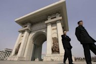 File photo shows two men passing the Arch of Triumph in the North Korean capital of Pyongyang in 2005. Japan and North Korea will hold inter-governmental talks in China later this month, Tokyo said Tuesday, in the first face-to-face meeting between the sides in four years