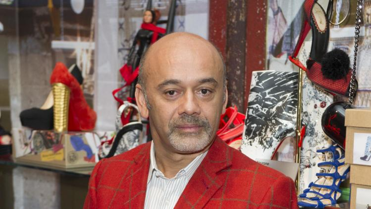 French shoe designer, Christian Louboutin, poses for photographers as he opens his first ever retrospective exhibition, at the Design Museum, London, Monday, April 30, 2012. The exhibition will be the first comprehensive presentation of Louboutin's work, and will showcase how he has helped transform the design of the shoe over the past 20 years. (AP Photo/Jonathan Short)