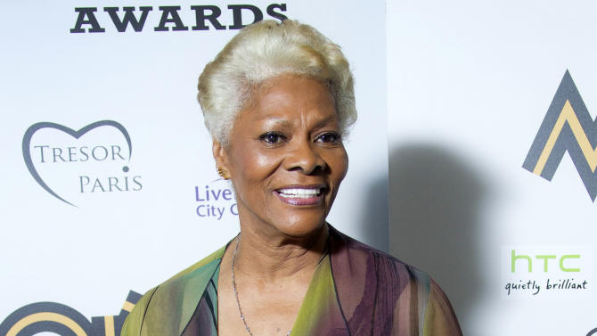 FILE - This Nov. 3, 2012 file photo shows singer Dionne Warwick after receiving the lifetime achievement award at the 2012 MOBO Awards in Liverpool. The music industry's largest record companies are suing Sirius XM Radio for royalties it says the satellite radio company didn't pay for recordings from before 1972. Sony, Universal and Warner, as well as ABKCO, an independent company that manages the music rights of acts like the Rolling Stones and The Animals, filed the lawsuit Wednesday, Sept. 11, 2013, in Los Angeles for unspecified damages and a judgment about the rights involved in pre-1972 recordings. Legendary artists Eric Burdon, Judy Collins, Sam Cooke (Estate), Steve Cropper, Duke Fakir, Sam Moore, Dionne Warwick, and Nancy Wilson support the case. (Photo by Joel Ryan/Invision/AP, file)