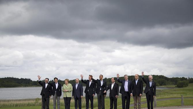 G-8 leaders from left, European Commission President Jose Manuel Barroso, Japan's Prime Minister Shinzo Abe, German Chancellor Angela Merkel, Russian President Vladimir Putin, British Prime Minister David Cameron, President Barack Obama, French President Francois Hollande, Canadian Prime Minister Stephen Harper, Italian Prime Minister Enrico Letta and European Council President Herman Van Rompuy pose during a group photo opportunity at the G-8 summit at the Lough Erne golf resort in Enniskillen, Northern Ireland, Tuesday, June 18, 2013. (AP Photo/Evan Vucci)