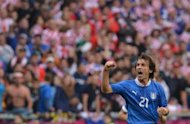 Italian midfielder Andrea Pirlo celebrates scoring during the Euro 2012 championships football match at the Municipal Stadium in Poznan. The match ended in a 1-1 draw