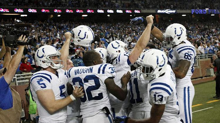Indianapolis Colts quarterback Andrew Luck with teammates after a 14-yard touchdown to wide receiver Donnie Avery as time expired against the Detroit Lions in the fourth quarter of an NFL football game in Detroit, Sunday, Nov. 2, 2012. Indianapolis won 35-33. (AP Photo/Paul Sancya)