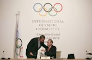 President of the International Olympic Committee (IOC) Jacques Rogge (C-R) speaks with Vice President Ser Miang NG during an Executive Board Meeting in central London. The IOC will not punish anyone ahead of the London Games over allegations that some national Olympic officials were breaking strict rules on selling tickets for the Games, the IOC Executive Board decided