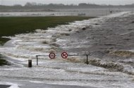 A barrier with traffic signs is seen on the North Sea beach near the town of Norddeich, December 5, 2013. REUTERS/Ina Fassbender