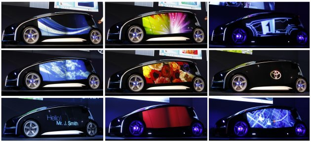 Various contents are seen on the varied display space of Toyota's concept vehicle Fun-Vii during its unveiling at a pre-Tokyo Motor show reception in a showroom in Tokyo in this combination photo