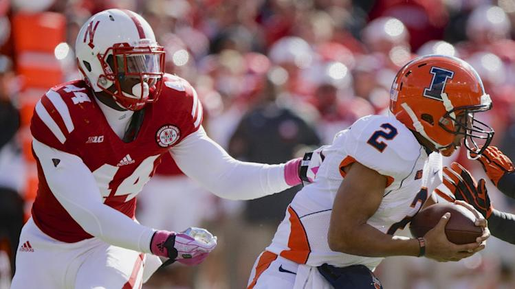 In this Oct. 5, 2013, file photo, Nebraska defensive end Randy Gregory (44) pursues and later sacks Illinois quarterback Nathan Scheelhaase (2) in an NCAA college football game in Lincoln, Neb. Following practice on Wednesday, March 12, 2014, Neb. coach Bo Pelini said that Gregory hasn't even scratched the surface of what he's going to become, what he's going to be
