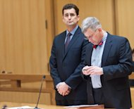 WCBS Television anchorman Rob Morrison, left, listens as his attorney Robert Skovgaard checks a cell phone during his arraignment in Superior Court on Tuesday Feb. 19, 2013 in Stamford, Conn. Morrison was arrested Monday night on charges of attacking his wife, Ashley Morrison, at their Connecticut home. He is charged with strangulation, threatening and disorderly conduct and ordered to to stay 100 yards away from his wife except when they&#39;re both at work. Ashley Morrison works for &quot;CBS Moneywatch.&quot; (AP Photo/New York Daily News, David Handschuh, Pool)