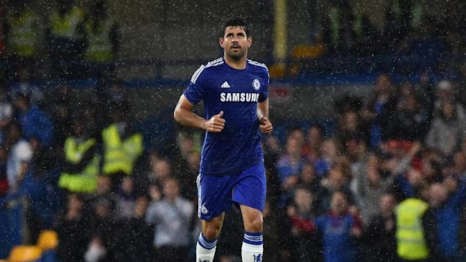 Chelsea's Brazilian-born Spanish striker Diego Costa reacts after scoring his second goal during the pre-season football friendly match between Chelsea and Real Sociedad at Stamford Bridge in London on August 12, 2014