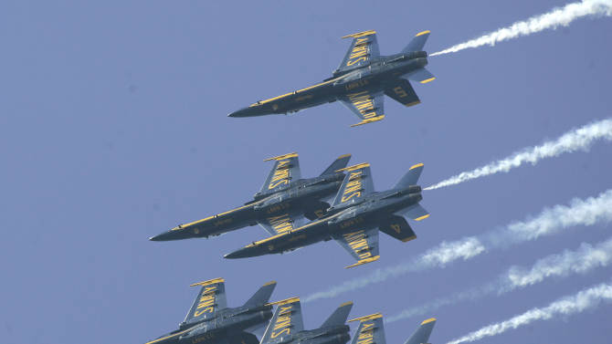 FILE - This Nov. 9, 2007 file photo shows the Blue Angels precision flight team leaving trails of smoke as they fly in formation during their final shows of the season at their home base in Pensacola, Fla. The National Naval Aviation Museum is located on Pensacola Naval Air Station in Pensacola, Fla., and is one of a number of free things to do in the Florida Panhandle area. Most Tuesday and Wednesday mornings March through November, visitors are treated to a performance by the U.S. Navy's Blue Angels flight demonstration squadron flying practices in the skies above the museum.  (AP Photo/Phil Coale, File)