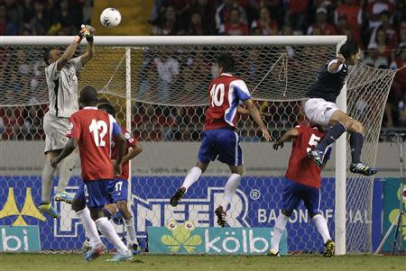 Costa Rica's goalkeeper Navas jumps for the ball near teammates Campbell, Ruiz, Borges and Cameron of the U.S. during their 2014 World Cup qualifying soccer match in San Jose