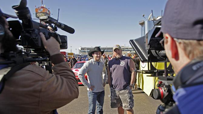 Frequent heartburn sufferer and comedian, Larry the Cable Guy & NASCAR driver, Austin Dillon hang out at the Phoenix International Raceway before the race to promote new Prilosec OTC Wildberry and encourage fans to enter the Wild American Flavor Sweepstakes at www.WildberryFlavor.com on Sunday, Nov. 11, 2012, in Avondale, Ariz.(AP Photo/Rick Scuteri)
