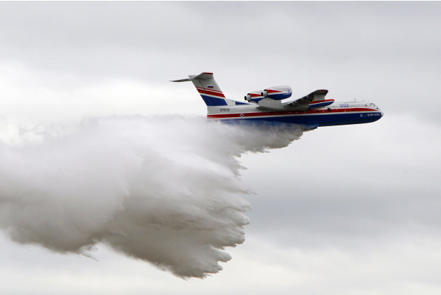 The Beriev - Be-200 multipurpose amphibious aircraft relases water during a demonstration flight at the 49th Paris Air Show at le Bourget airport, east of Paris, Tuesday June 21, 2011. (AP Photo/Franc