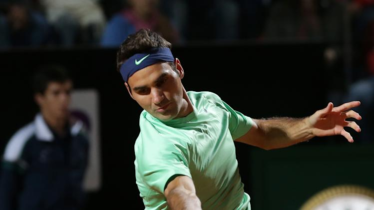 Switzerland's Roger Federer returns the ball to Poland's Jerzy Janowicz during their match at the Italian Open tennis tournament in Rome, Friday, May 17, 2013. (AP Photo/Riccardo De Luca)