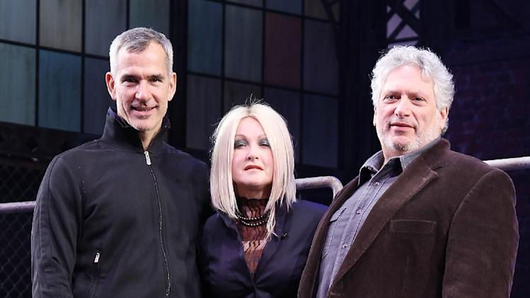 "This Feb. 28, 2013 photo released by Starpix shows, from left, choreographer Jerry Mitchell, Cyndi Lauper and Harvey Fierstein at the open house for the Upcoming Musical ""Kinky Boots,"" featuring Music by Cyndi Lauper, at the Al Hirshfeld Theatre in New York. (AP Photo/Starpix, Kristina Bumphrey)"