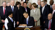 FILE - In this March 23, 2010 file photo President Barack Obama signs the health care bill in the East Room of the White House in Washington. He is flanked by Marcelas Owens of Seattle, left, and Rep. John Dingell, D-Mich. Behind, from left are, Sen. Tom Harkin, D-Iowa., Senate Majority Whip Richard Durbin of Ill., Vice President Joe Biden, Vicki Kennedy, widow of Sen. Ted Kennedy, Sen. Christopher Dodd, D-Conn., Rep. Sander Levin, D-Mich., Ryan Smith of Turlock, Calif., Health and Human Services Secretary Kathleen Sebelius, House Speaker Nancy Pelosi of Calif., House Majority Leader Steny Hoyer of Md., Senate Majority Leader Harry Reid of Nev., Rep. Patrick Kennedy, D-R.I., House Majority Whip James Clyburn of S.C., and Rep. Henry Waxman, D-Calif. The Supreme Court said Monday it will hear arguments in March over President Barack Obama's health care overhaul, setting up an election-year showdown over the White House's main domestic policy achievement. (AP Photo/J. Scott Applewhite, File)