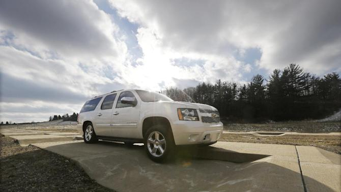 """In a Jan. 17, 2013 photo, a Chevrolet Suburban is driven through the uneven terrain course at the General Motors Milford Proving Grounds in Milford, Mich.  It's in this northwest Detroit suburb that GM has its testing facility, which, according to GM consumer affairs chief James Bell, exists for the purpose of beating """"the heck out of a vehicle before the customer can."""" Founded in 1924, the 4,000-acre Milford Proving Grounds was the first dedicated automotive testing facility in the world, and remains one of the largest to this day. (AP Photo/Carlos Osorio)"""