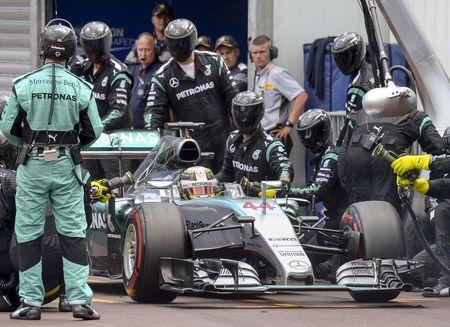 Mercedes Formula One driver Hamilton of Britain stops at his stand during the Monaco Grand Prix in Monaco