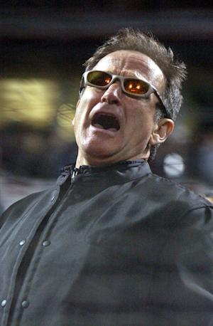 """FILE - In this Oct. 22, 2002 file photo, actor Robin Williams sings """"Take Me Out to the Ballgame"""" in the seventh inning during game 3 of the World Series in San Francisco. Williams was everywhere in San Francisco, it seemed, as he made a place for himself in the everyday fabric of a city where he once said he passed for normal. (AP Photo/Julie Jacobson, File)"""