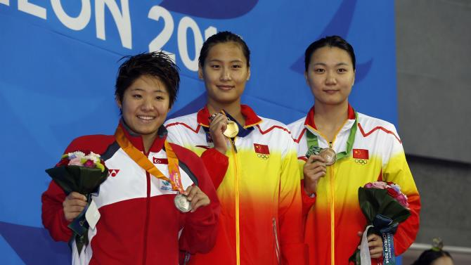 Medallists smile after their women's 50m butterfly final at the Munhak Park Tae-hwan Aquatics Center during the 17th Asian Games in Incheon