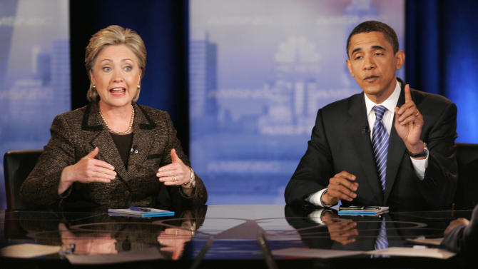 "FILE - In this Feb. 26, 2008, file photo, then Democratic presidential hopefuls Sen. Hillary Rodham Clinton, D-N.Y., left, and Sen. Barack Obama, D-Ill., respond to a question during a Democratic presidential debate in Cleveland. Mitt Romney pulled the plug on his first presidential run on Feb. 7, 2008, and immediately served notice that he wasn't about to fade away. ""I hate to lose,"" he told conservatives that day. Obama wasn't paying too much attention to Romney just then. The first-term Illinois senator was in a bare-knuckled brawl with Clinton for the Democratic presidential nomination and, if he got past the New York senator and former first lady, was calculating his odds of defeating Republican Sen. John McCain.(AP Photo/Mark Duncan, File)"
