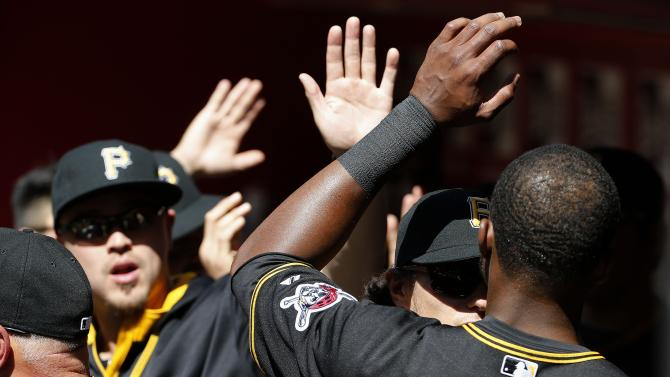 Pittsburgh Pirates' Gregory Polanco gets high-fives from teammates in the dugout after scoring a run against the Arizona Diamondbacks during the fifth inning of a baseball game, Sunday, April 26, 2015, in Phoenix. (AP Photo/Ross D. Franklin)