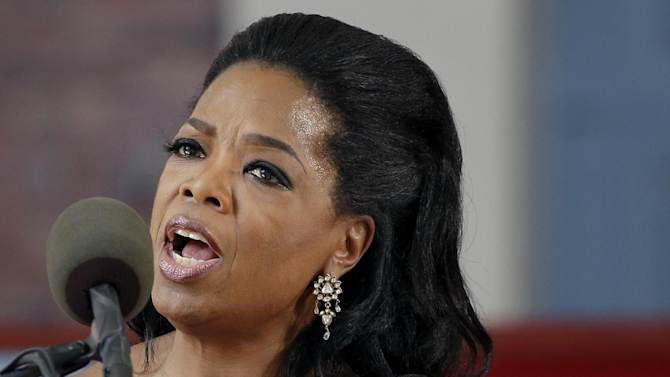 FILE - In this May 30, 2013 file photo, Oprah Winfrey speaks during Harvard University's commencement ceremonies in Cambridge, Mass. President Barack Obama will bestow the nation's highest civilian honor on Oprah Winfrey and former President Bill Clinton later this year. Clinton and Winfrey will receive the Presidential Medal of Freedom at the White House along with 14 others, including former Sen. Richard Lugar and women's rights activist Gloria Steinem. (AP Photo/Elise Amendola, File)